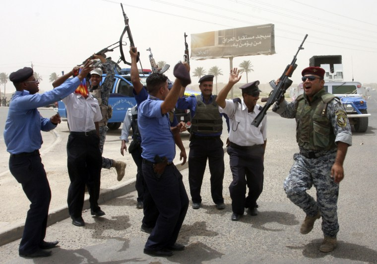 Image: Iraqi security forces celebrate during the withdrawal of U.S. troops in Baghdad