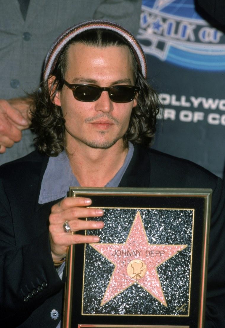 Johnny Depp Holding His Star
