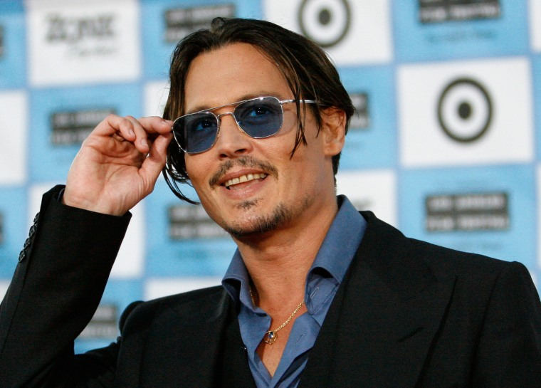 """Depp attends the premiere of the movie """"Public Enemies"""" at the Mann Village theatre in Westwood"""