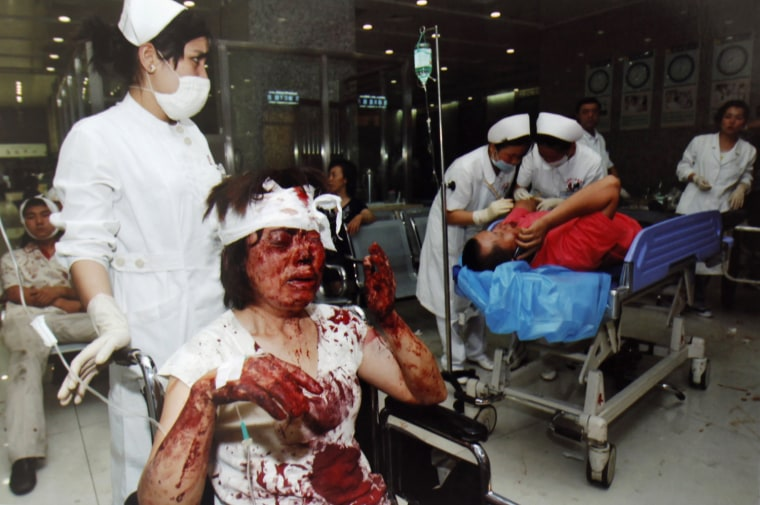Image: Handout photo shows wounded people attended by medical staff following riots in Urumqi, Xinjiang Autonomous Region, in China