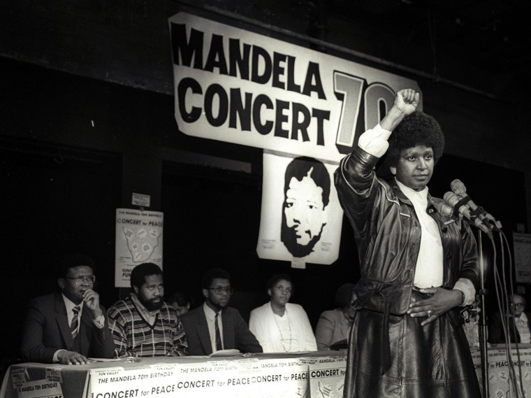 File photo of Winnie Mandela raising her fist after announcing massive pop concert will be held to mark the 70th birthday of Nelson Mandela