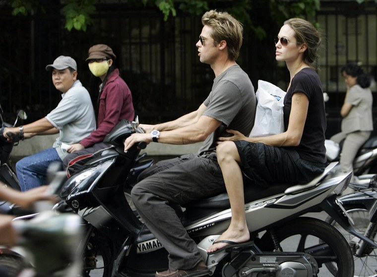 Hollywood movie stars Brad Pitt (C) and
