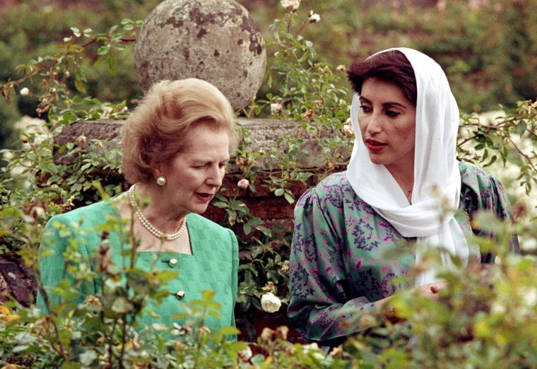 ** FILE ** Pakistan's opposition leader Benazir Bhutto walks with then British Prime Minister Margaret Thatcher in the rose garden at Chequers, Thatcher's country residence, in this July 8, 1989 file photo. Bhutto was assassinated Thursday Dec. 27, 2007, in a suicide attack that also killed at least 20 others at the end of a campaign rally, in Rawalpindi, Pakistan. A party security adviser said Bhutto was shot in neck and chest as she got into her vehicle to leave the rally in Rawalpindi . A gunman then blew himself up.(AP Photo/pa-file) ** UNITED KINGDOM OUT: NO SALES: NO ARCHIVE: **