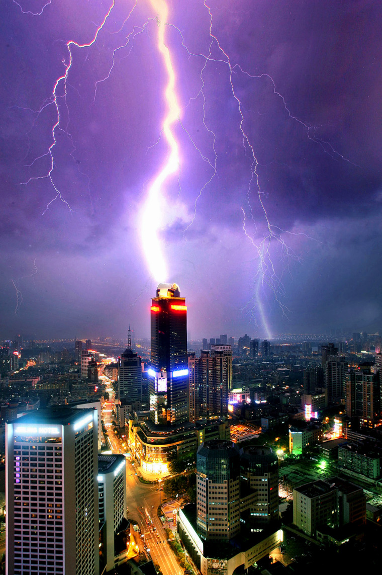Lighting strikes over buildings in Nanjing, in China's eastern Jiangsu province Tuesday Aug. 1, 2006. (AP Photo/EyePress) ** CHINA OUT **