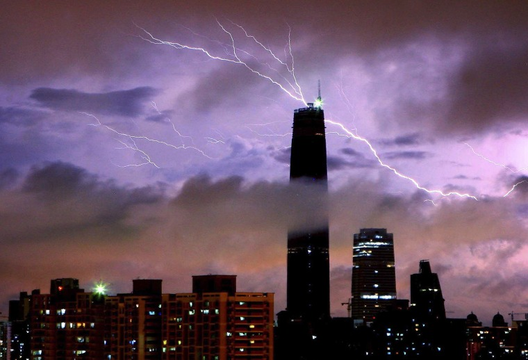 In this photo taken Wednesday, June 3, 2009, lightning strikes over Guangzhou International Finance Center during a rainstorm in Guangzhou, south China's Guangdong province. (AP Photo) ** CHINA OUT **