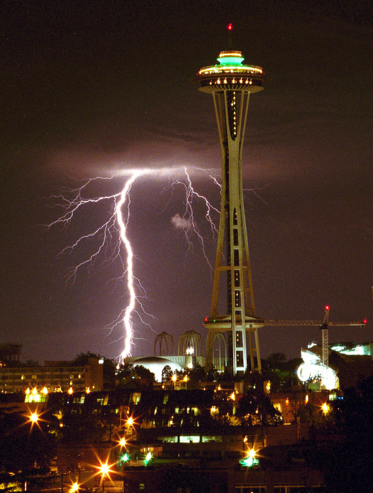 Lightning strikes west of the Space Needle, late Wednesday, Aug. 4, 1999, in Seattle, Wash., during a storm that rolled through the Puget Sound area. (AP Photo/Eastside Journal, Patrick Hagerty)