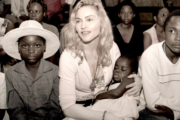 Publicity photo of pop star Madonna and the Malawi child she hopes to adopt, Mercy