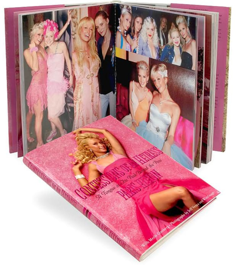 """Confessions of an Heiress: A Tongue-in-Chic Peek Behind the Pose  by Paris Hilton, May 2006  Book overview Paris Hilton has a lifestyle most girls dream about. Her name is on everyone's lips -- but can she help it if she was born rich and privileged? Now, with a sly sense of humor and a big wink at her media image, Paris lets you in for a sneak peek at the life of a real, live heiress/model/actress/singer/it-girl and tells you how anyone can live a fairy-tale life like hers. """"If you follow your own plans and dreams and you don't let anyone talk you out of them, then you'll start to get the hang of being an heiress....All you need after that is a good handbag, a great pose, and very high heels, and you're on your way. (Long blond hair doesn't hurt, either.)""""  In her fabulous and very tongue-in-cheek -- and chic -- guide, you'll discover Paris's twenty-three rules for How to Be an Heiress (Never have only one cell phone when you can have many), Paris's list of Twelve Things an Heiress Would Never Do (Go out the night after the Oscars), and Three Things Most People Think Heiresses Shouldn't Do, But I Think They Should (Go out with broke guys). Paris also shares private information such as her memories of growing up with her sister, Nicky, and family photos; her favorite designers and her unique beauty secrets; what a night out with Paris is like; her personal gallery of fashion don'ts; and behind-the-scenes stories from both installments of her hit television series, The Simple Life. Of course no book by Paris would be complete without her pet teacup Chihuahua, Tinkerbell, and in these pages, the best-dressed dog in the world shares pages from her own secret diary.  Featuring more than three hundred fabulous color photos of Paris, Confessions of an Heiress is a look at life from the unique perspective of a young woman who has the whole world at her stiletto-clad feet."""