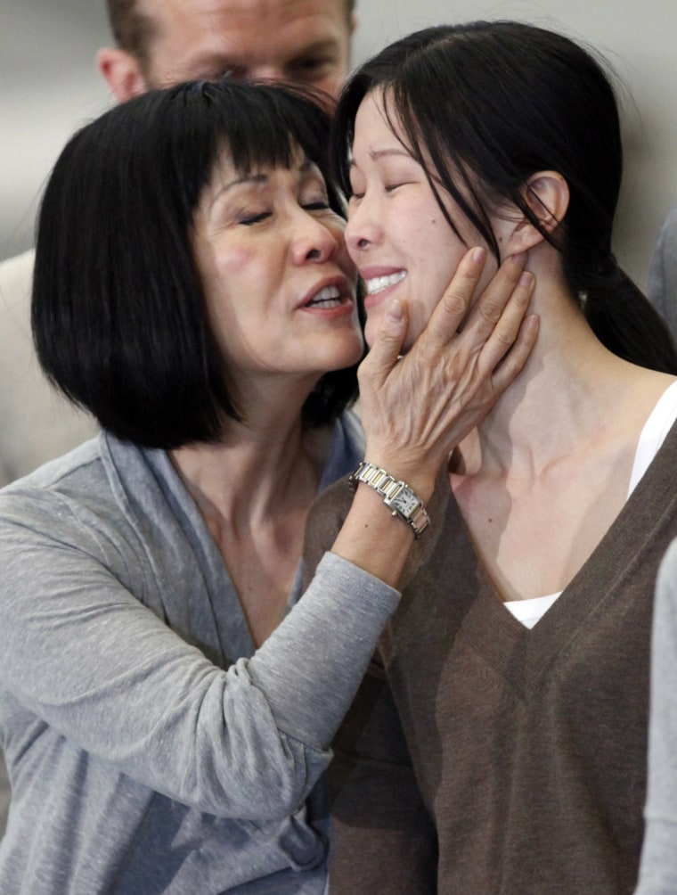 Image: Freed US journalist Ling is kissed by her mother after arriving with fellow journalist Lee from North Korea in Burbank, California