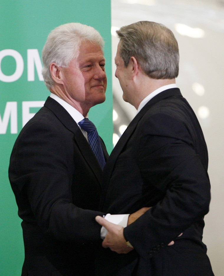 Image: Former Vice-President Al Gore embraces former President Bill Clinton in Burbank