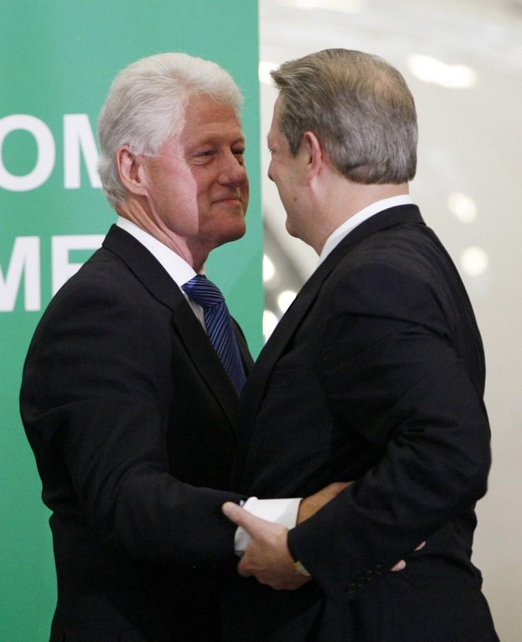 Image: Former Vice-President Al Gore embraces former President Bill Clinton in Burbank