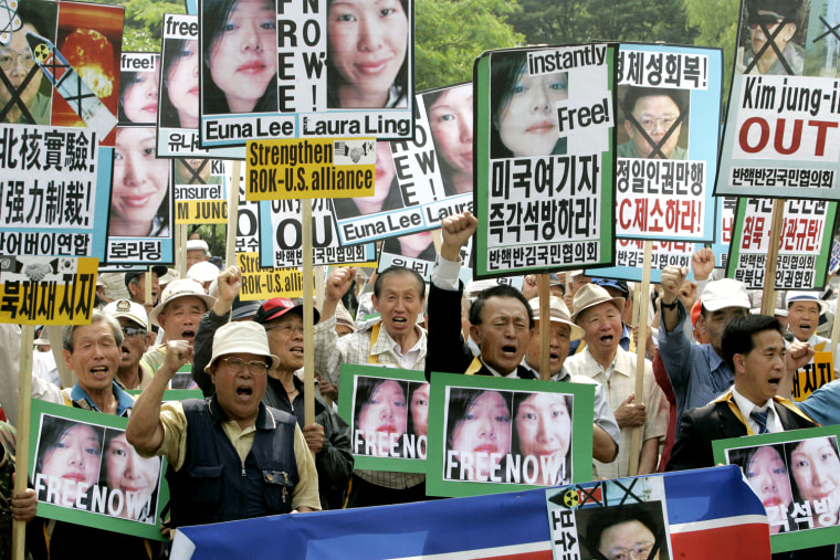 "Protesters shout slogans during a rally Thursday, June 4, 2009 at a park in Seoul, South Korea to coincide with the trial that opened in North Korea Thursday of two American journalists accused of entering North Korea illegally and engaging in ""hostile acts."" Laura Ling and Euna Lee, reporters for former U.S. Vice President Al Gore's California-based Current TV media venture, were arrested March 17 near the North Korean border while on a reporting trip to China. The sign read, ""Release Immediately American Journalists!"" (AP Photo/Bullit Marquez)"