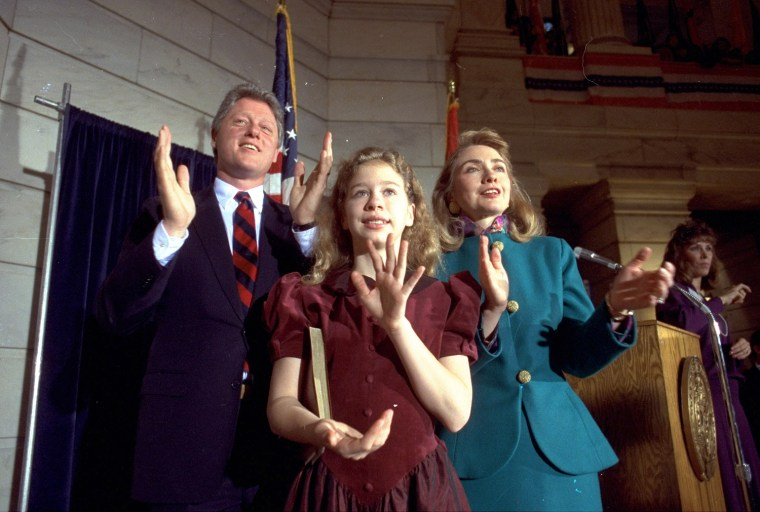 Arkansas Governor Bill Clinton is pictured here with his wife Hillary Rodham Clinton and their daughter Chelsea Clinton in Little Rock on September 20, 1991 celebrating his inauguration as Governor.  (AP Photo/Danny Johnston)