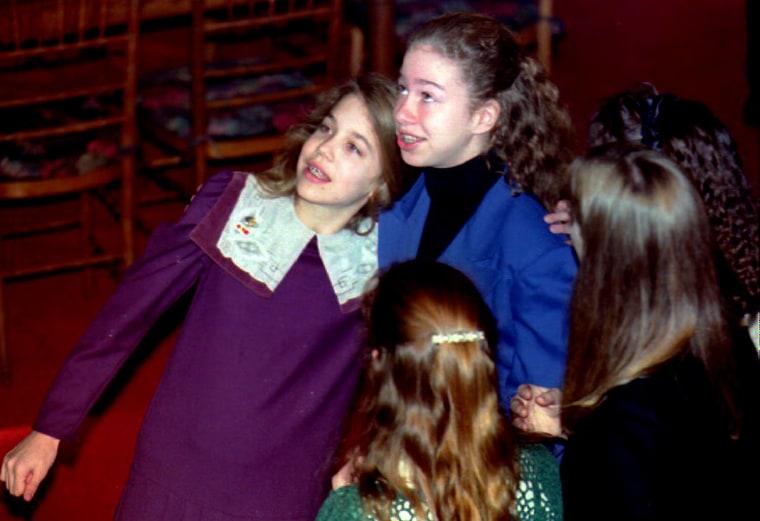 Chelsea Clinton (C) hugs schoolfriend Elizabeth Fl