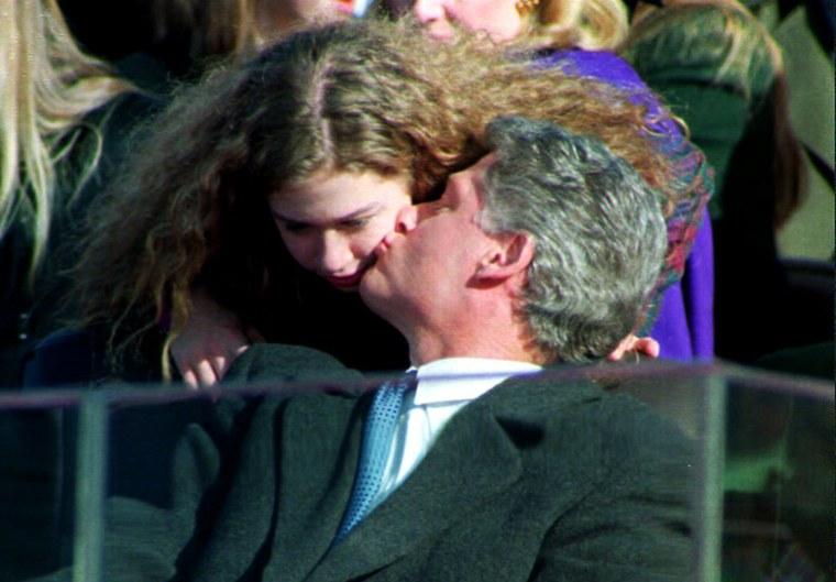 U.S. President Bill Clinton kisses his daughter Ch