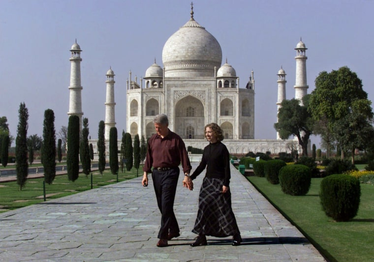 Chelsea Clinton takes the hand of her father, President Clinton, as they walk past the gardens of the Taj Mahal in Agra, India, Wed., March 22, 2000. The president and his daughter plan to spend a few days sightseeing after dealing with matters of state in New Delhi earlier this week. (AP Photo/J. Scott Applewhite)