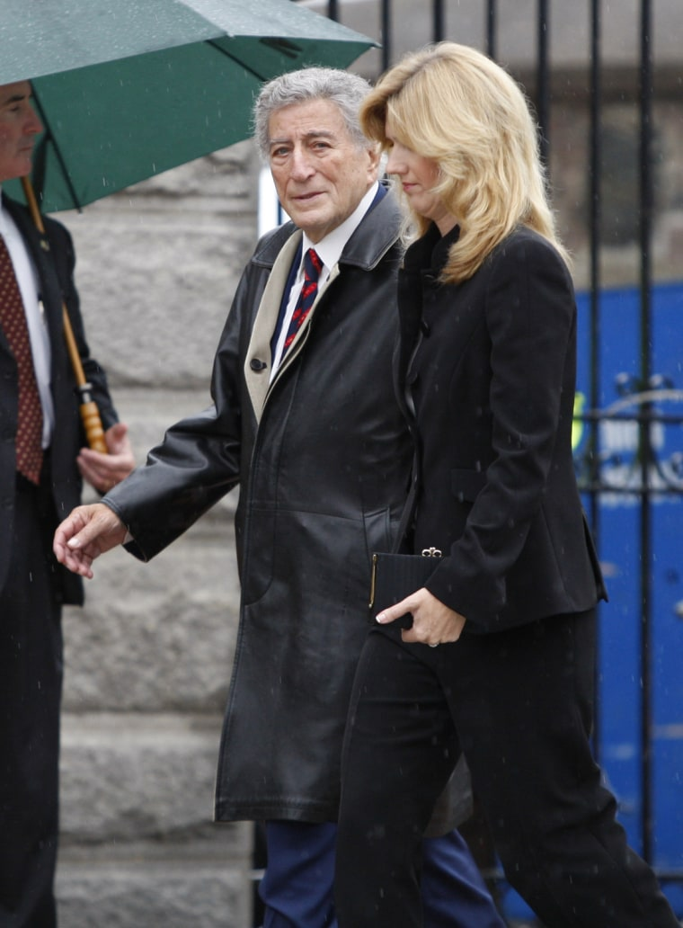 Image: Singer Bennett and his wife Crow arrive for the funeral services of U.S Senator Edward Kennedy in Boston