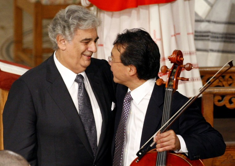 Image: Tenor Placido Domingo hugs cellist Yo-Yo Ma after they performed during funeral of U.S. Senator Kennedy in Our Lady of Perpetual Help Basilica in Boston