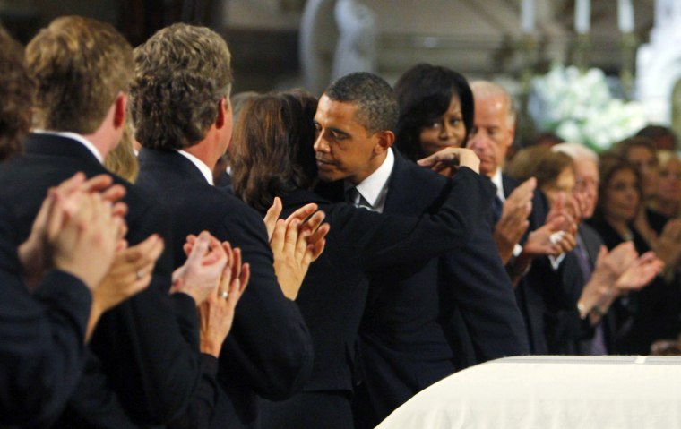 Image: U.S. President Barack Obama hugs Vicki Reggie Kennedy after delivering his eulogy during funeral services for Kennedy in Boston