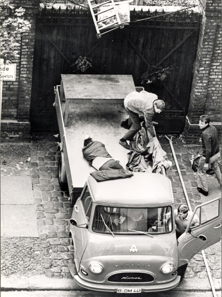 Escapee In Lorry By Berlin Wall
