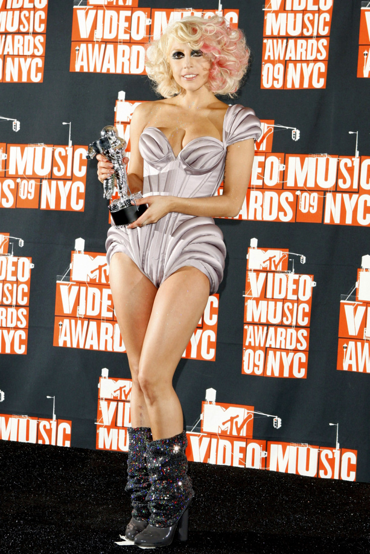Image: Lady Gaga stands backstage with the best new artist award at the 2009 MTV Video Music Awards in New York