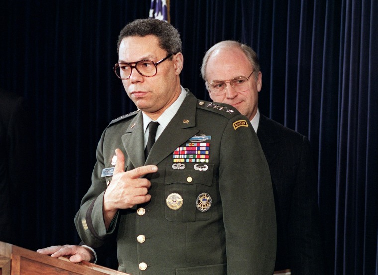 US Defense Secretary Dick Cheney (R) stands by as
