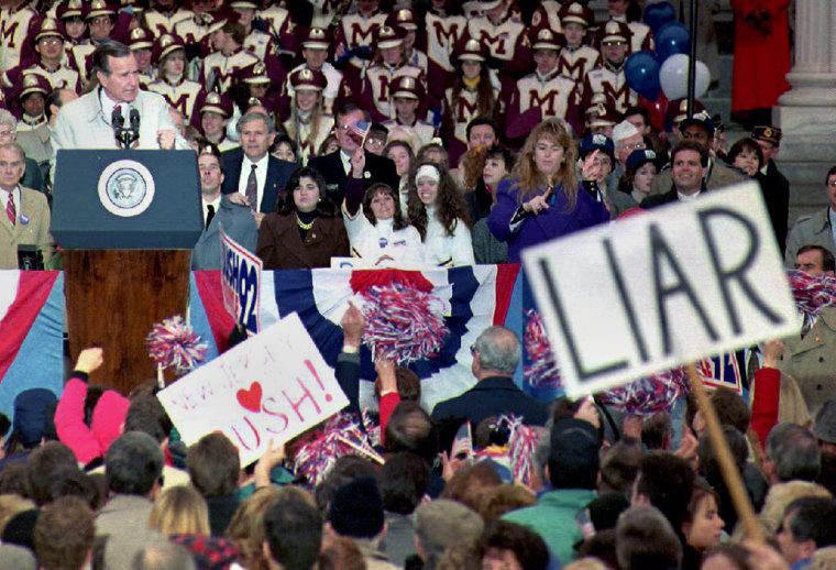 U.S. President George Bush (L) speaks to a large