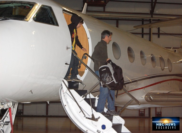 Exclusive images taken by NBC of David and Sean Goldman returning to the U.S.