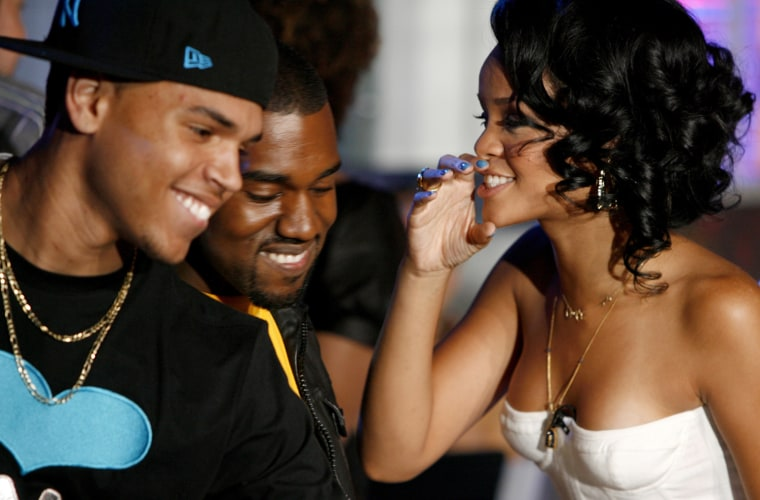 """Recording artists Chris Brown and Kanye West laugh with Rihanna during a Video Music Awards nomination special """"TRL"""" show at the MTV studios in New York"""