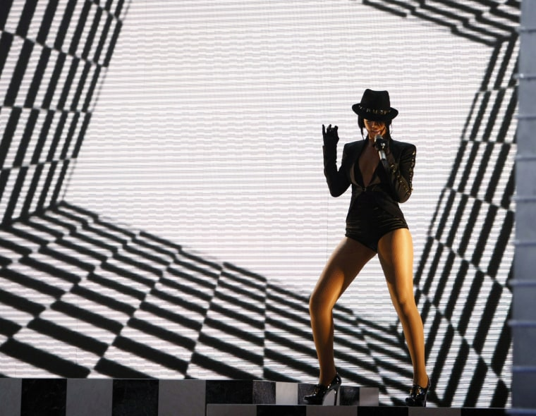 """Rihanna performs """"Umbrella"""" at the 2007 MTV Video Music Awards in Las Vegas September 9, 2007. Rihanna won the award for Monster Single of the Year for the song"""