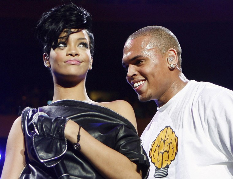 Image: File photo of musicians Chris Brown and Rihanna during the Z100 Jingle Ball in New York