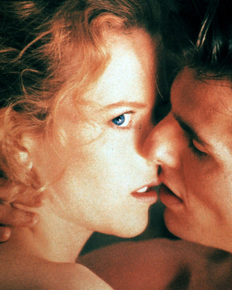 TOM CRUISE AND NICOLE KIDMAN IN SCENE FROM EYES WIDE SHUT