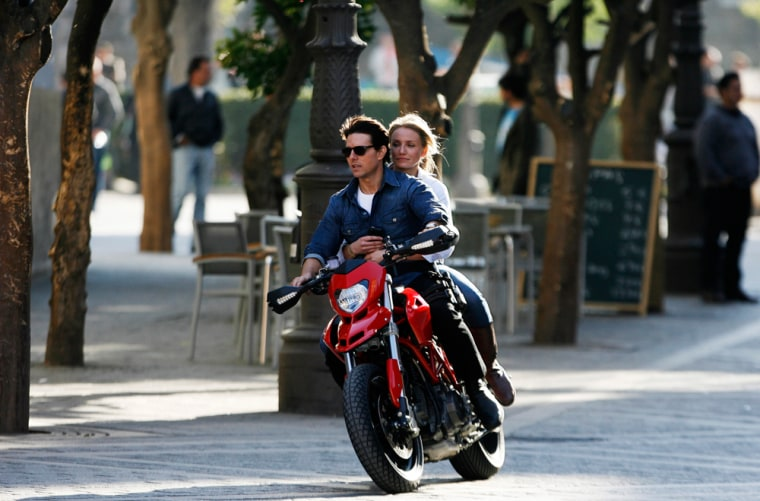 "Image: Tom Cruise and Cameron Diaz ride a motorbike on the set of  ""Knight & Day"" in Seville"