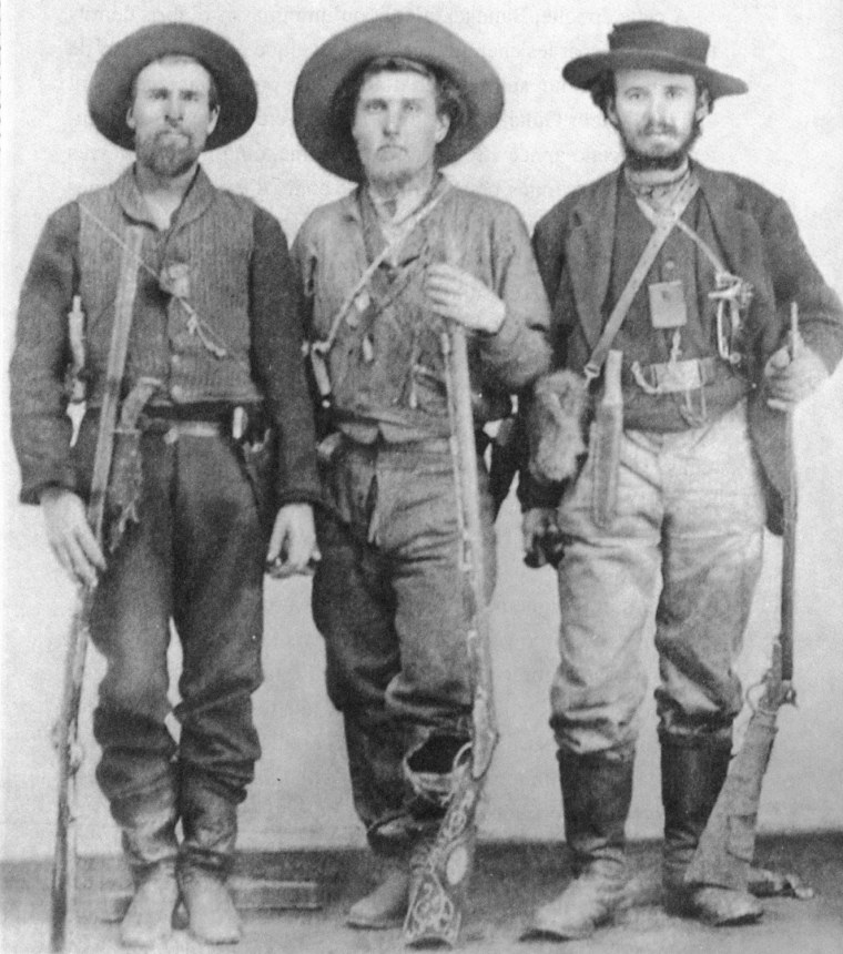 William Andrews Clark, right, with fellow miners at Bannack, Mont., c. 1862.