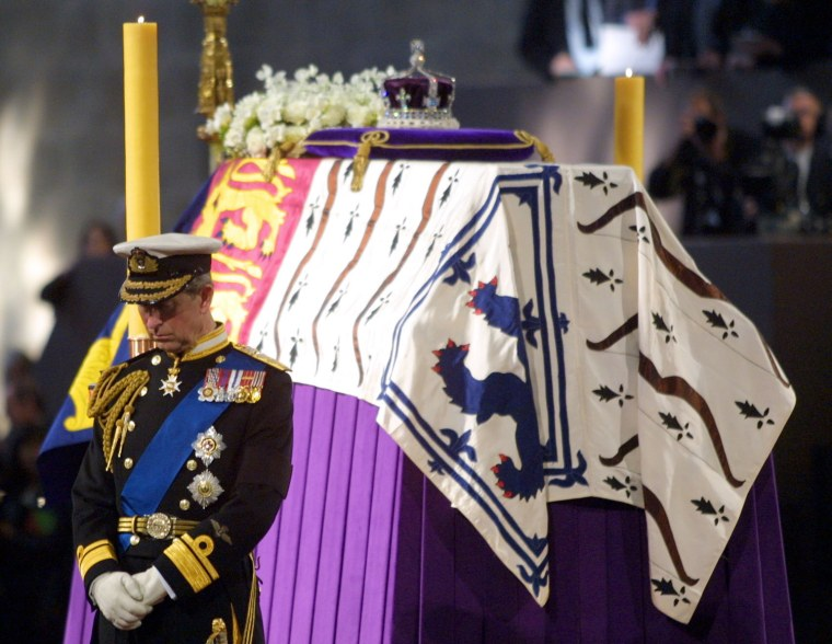 Image: Prince Charles stands vigil beside the Queen Mothe