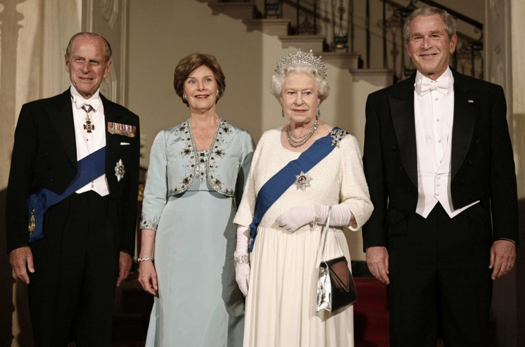 U.S. President George W. Bush, First Lady Laura Bush, Britain's Queen Elizabeth II and Prince Philip, the Duke of Edinburgh pose for a picture at the Grand Foyer of the White House for a State Dinner in Washington