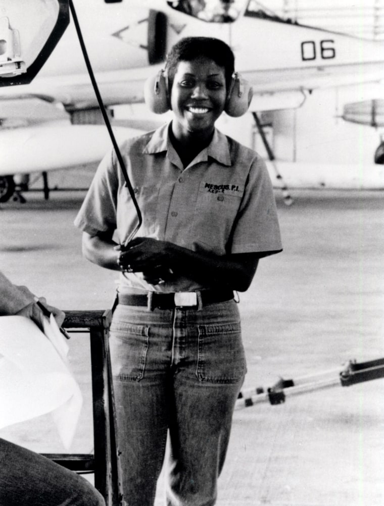 Petty Officer 2nd Class Patricia Mescus, US Navy, repairs an A-4 jet, Kadena Air Force Base, Okinawa, Japan, 1976.    Patricia Mescus Collection, Women In Military Service For America Memorial Foundation, Inc.
