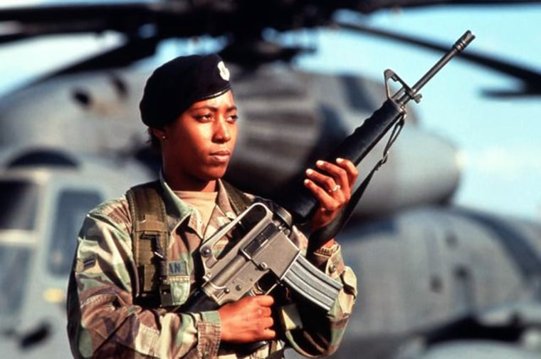 """Released to Public ID:DFST0203025Service Depicted: Air Force  A USAF female security policeman stand guard on the flight line armed with a 5.56 mm M16A2 assault rifle. Today, active duty women in the entire Department of Defense comprise 11 percent of or the active duty force and 13 percent of the Reserve force. From Airman Magazine's December 1994 issue """"Inside Front Cover"""" and article """"Women in the Air Force: Completing the Evolution"""". Camera Operator: MSGT MIKE REINHARDT Date Shot: 1 Dec 1994"""