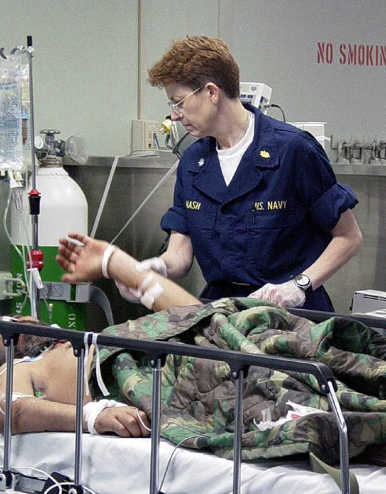 030410-N-4182M-009 The Arabian Gulf (Apr. 10, 2003) -- Cmdr. Linda Nash, Nurse Corps, evaluates an Iraqi patient in the casualty receiving area aboard the hospital ship USNS Comfort (T-AH 20). Comfort is deployed conducting missions in support of Operation Iraqi Freedom. Operation Iraqi Freedom is the multinational coalition effort to liberate the Iraqi people, eliminate Iraq's weapons of mass destruction and end the regime of Saddam Hussein.  U.S. Navy photo by Journalist Seaman Erica Mater.  (RELEASED)