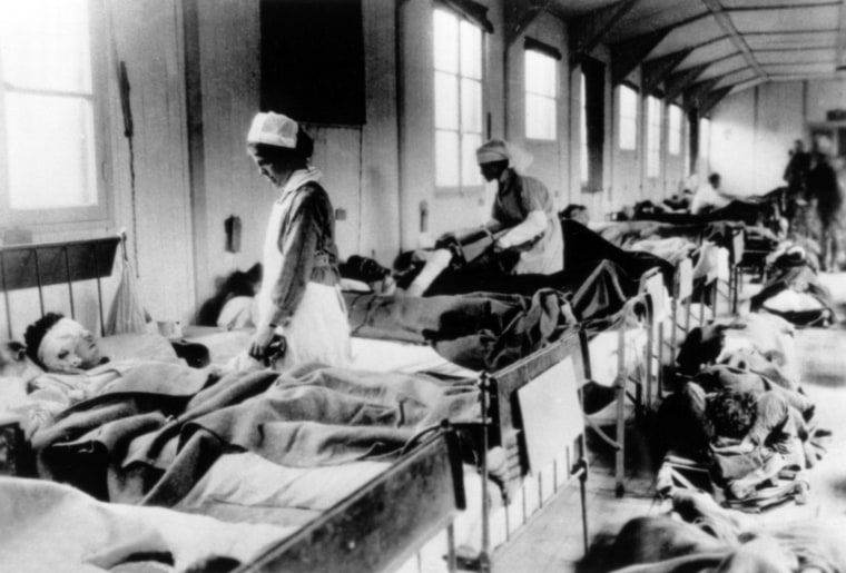 An Army nurse tends to a wounded solider in the crowded Evacuation Hospital No. 114, Fleury-sur-Aire, France, World War I.  National Archives (111-SC-26535)