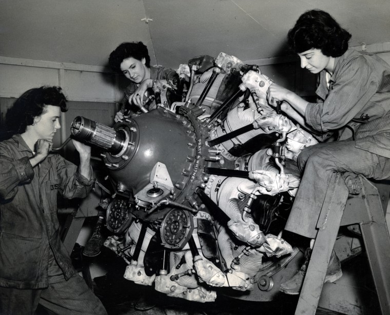 Women Marine Privates Bette Wimer, Betty West and Reba Fitzgerald learn to disassemble aircraft engines for major overhauling, Assembly and Reparir School, Marine Corps Air Station, Cherry Point, NC, 1943. US Marine Corps Photograph, LaVeta (Edge) Francis Collection, Women In Military Service For America Memorial Foundation, Inc.