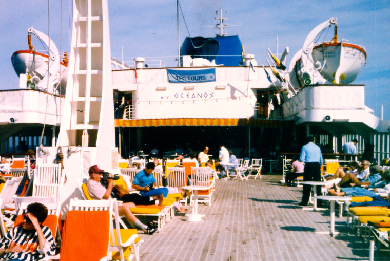 July 1991. Vacationers enjoy the pool deck early in the cruise.