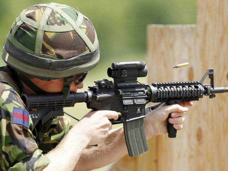 Image: Britain's Prince Harry shoots on a firing range during a visit to the U.S. Military Academy at West Point in New York