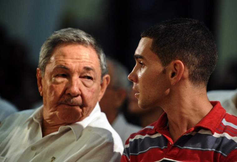 Image: Cuban President Raul Castro (L) and Elian Gonzalez (R) attend a religious ceremony to commemorate the 10th anniversary of Elian's return to the island