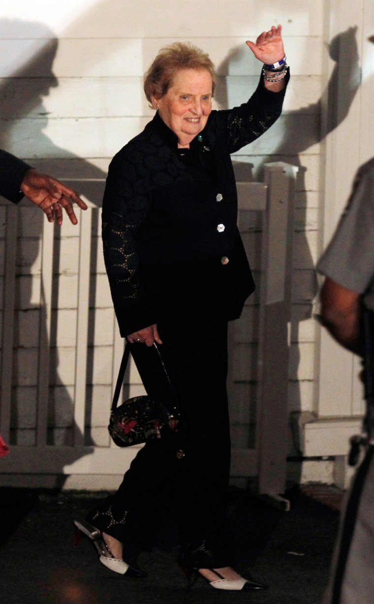 Image: Former U.S. Secretary of State Madeline Albright waves as she leaves an after-party for Chelsea Clinton in Rhinebeck