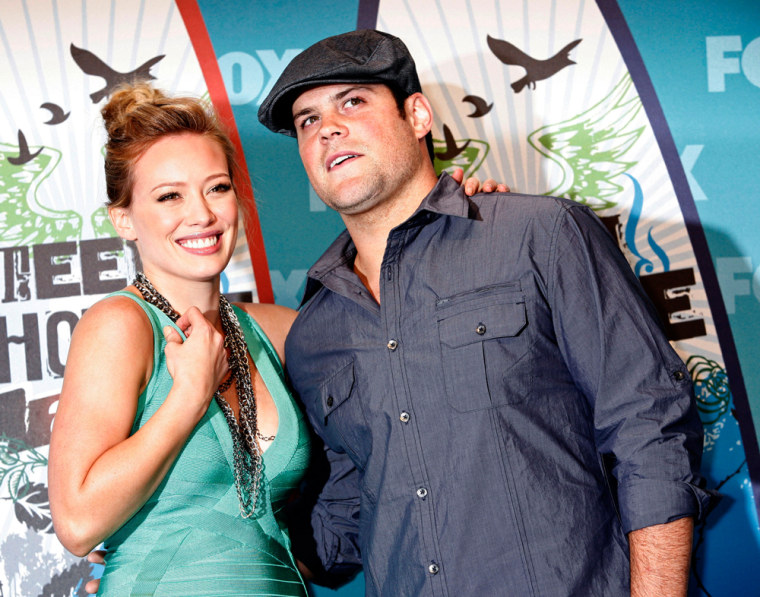 Image: Actress and singer Hilary Duff and hockey player Mike Comrie pose in the press room at the Teen Choice 2010 Awards in Los Angeles