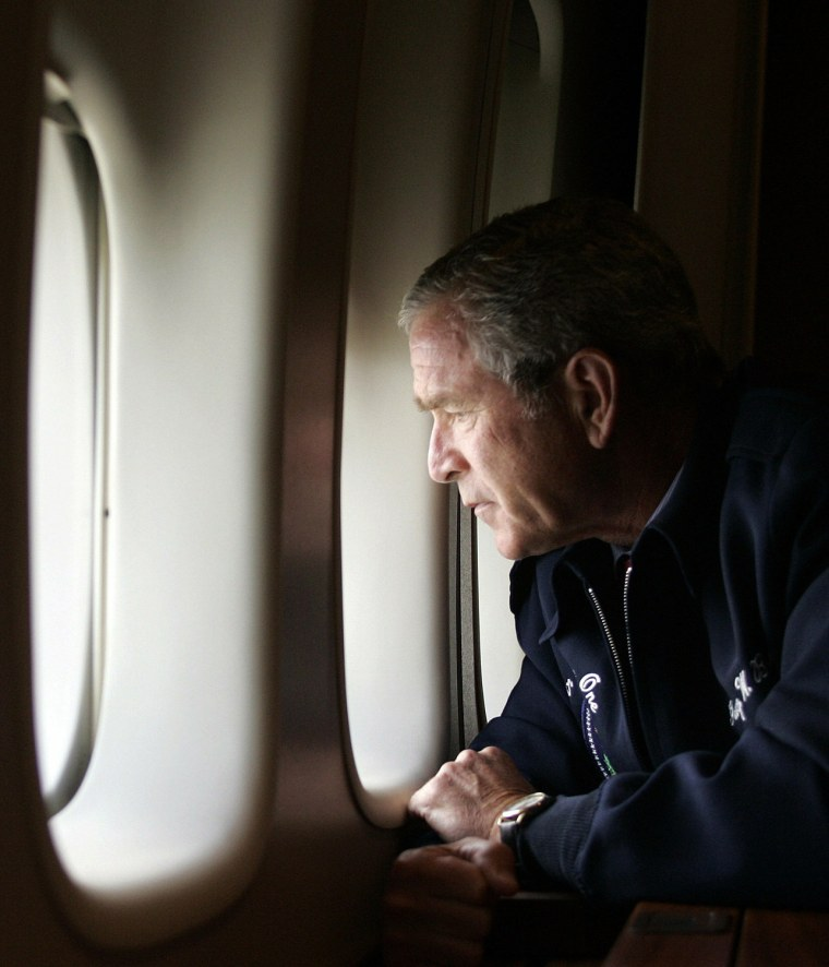 Image: US President George W. Bush looks out th