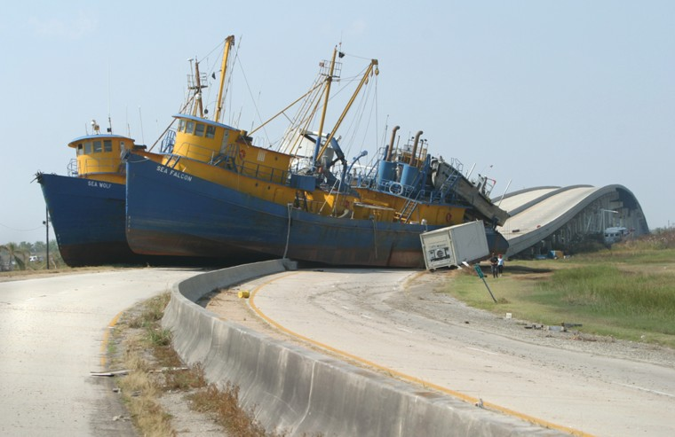 Two 160-foot fishing vessels straddle all four lanes of Highway 23 in Empire, La., Sept. 12 after being pushed ashore by Hurricane Katrina.  Sustained winds from the Category 4 storm were measured in excess of 135mph near Empire.