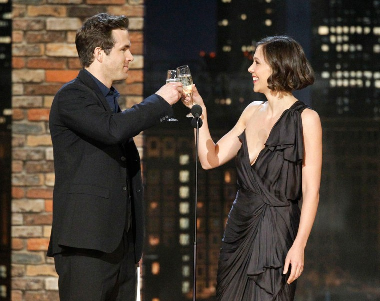 Image: Presenters Ryan Reynolds and Maggie Gyllenhaal toast the evening at the 25th Film Independent Spirit Awards in Los Angeles