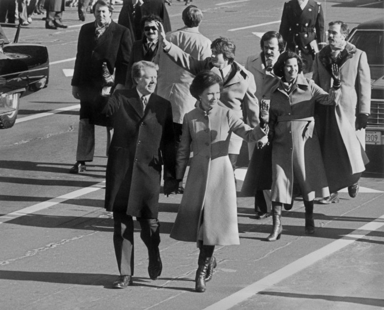 Image: Walking hand in hand, ex President Jimmy Carter ac